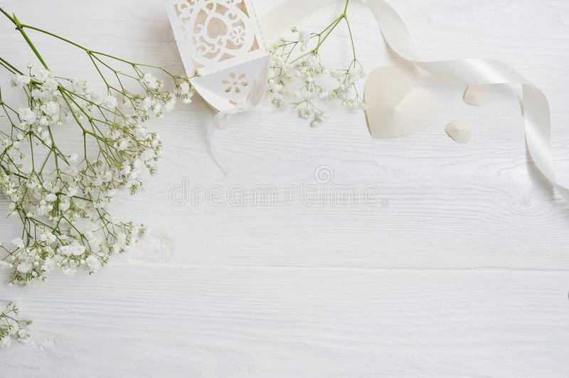 Mock up Composition of white flowers rustic style, hearts and a gift for St. Valentine`s Day with a place for your text. Flat lay royalty free stock photo
