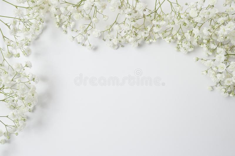 Mock up Composition of white flowers rustic style with a place for your text. Flat lay, top view photo mock up royalty free stock photo
