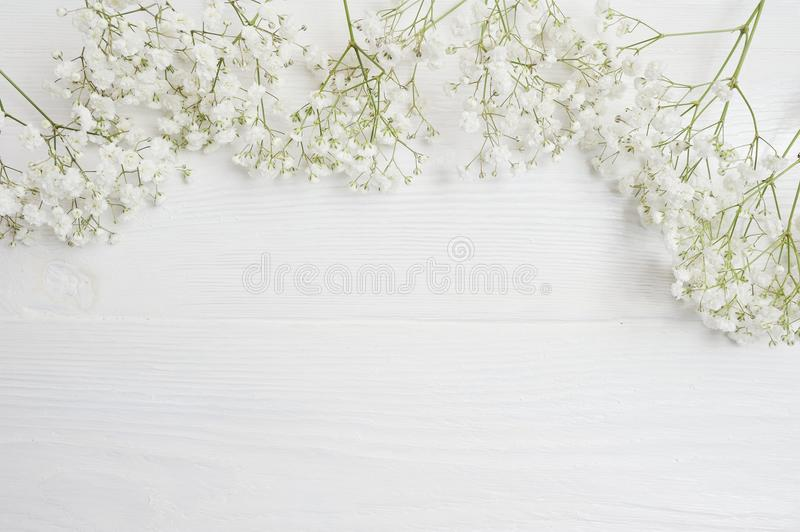 Mock up Composition of white flowers rustic style, for St. Valentine`s Day with a place for your text. Flat lay, top royalty free stock image
