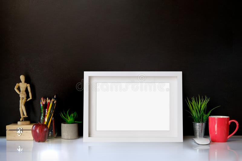 Mockup poster on creative workspace royalty free stock photo