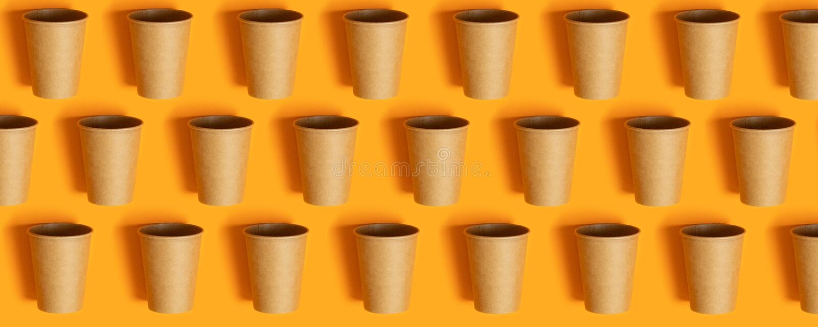 Mock up with copy space. Paper cups on orange background with copy space stock photography
