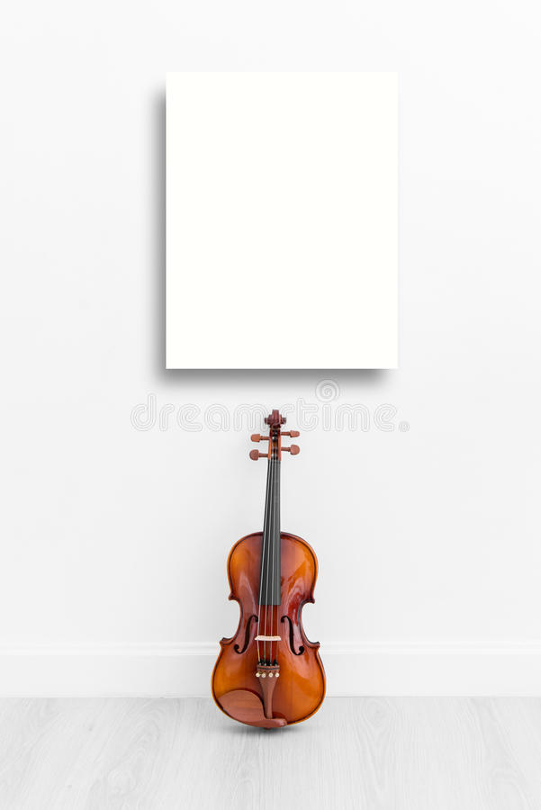 Mock up displya and Classical cello on white wall. Background with copy space stock image