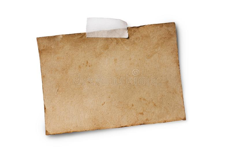Mock up of empty old vintage tinted paper sheet on adhesive tape. Mockup of empty old vintage yellowed paper sheet with scotch tape isolated on white background stock photo