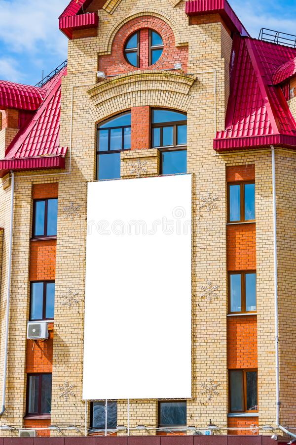 Mock up on an empty poster on the wall of the city building, illuminated by the sun,. Cityscape stock photos