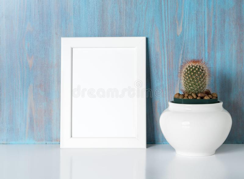 Mock up frame on blue wooden wall stock image