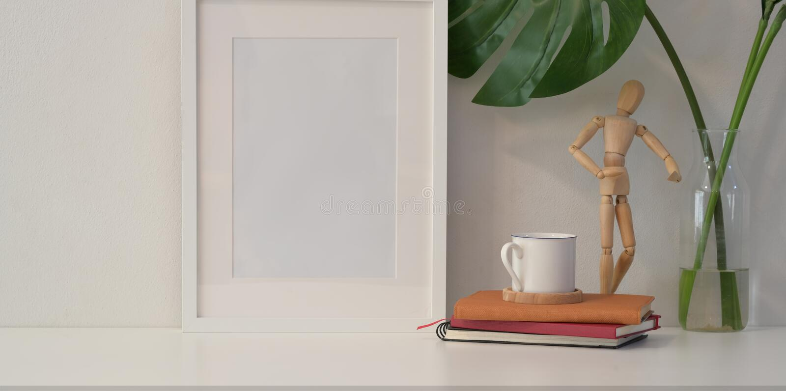 Mock up frame on white wall in minimal style royalty free stock photos