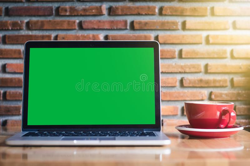 Mock-up Green Screen Monitor on wooden table. Mock-up Green Laptop Screen Monitor on wooden table stock images