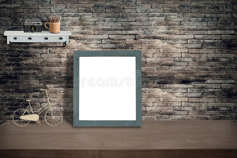 Mock up green wooden photo frame and supplies on wooden table royalty free stock photos