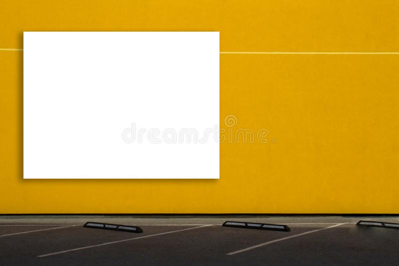 Mock up of blank billboard outdoors, outdoor advertising, public information board on the wall near parking area. Mock up of horizontal blank billboard outdoors stock image