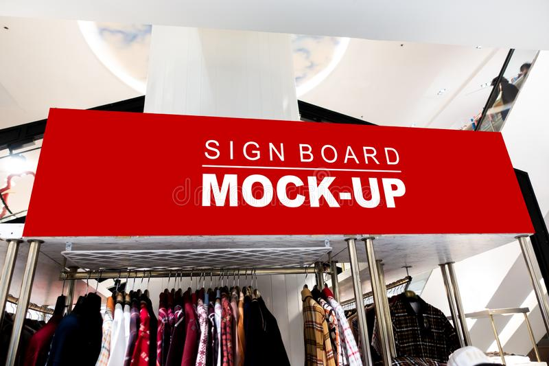 Mock up horizontal over showcase in clothing shop. Mock up large horizontal blank banner or signboard with clipping path to show promotion or discount in shop royalty free stock image