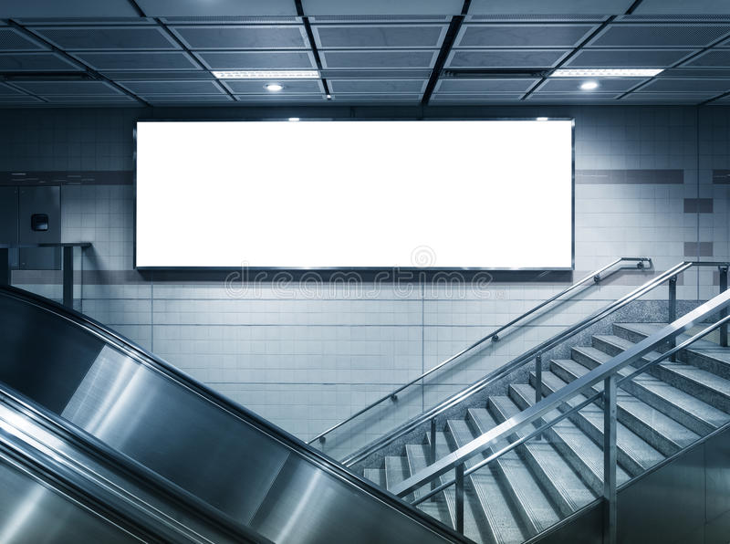 Mock up Horizontal poster neon sign in station. Mock up Horizontal poster neon commercial sign box in subway station stock images