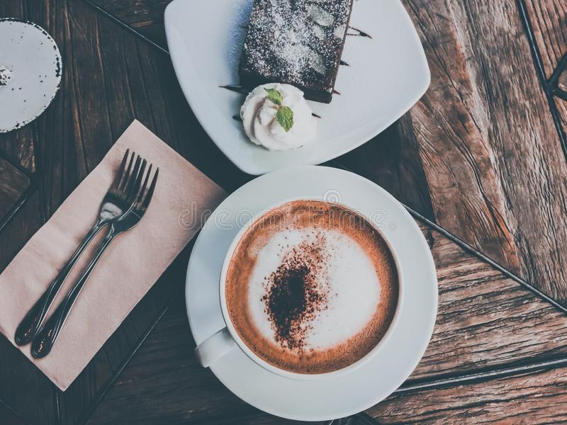 Close up hot coffee cappuccino with chocolate cake royalty free stock photos