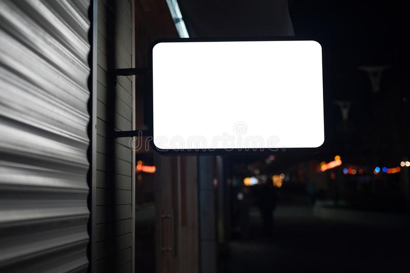 Mock up of illuminated blank signboard in night city. Place for text, outdoor advertising, banner or public information royalty free stock images