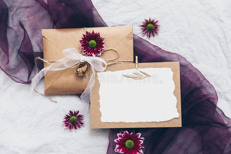 Mock up Kraft wedding invitation set with eucalyptus branch on linen background stock images