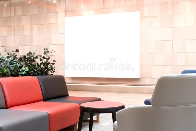 Mock up. Large blank banner in the showcase of store in modern shopping mall royalty free stock photos