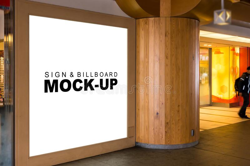 The mock up large wooden signboard at shopping mall. The mock up large wooden signboard modern design with clipping path, blank white space for advertising or royalty free stock photos