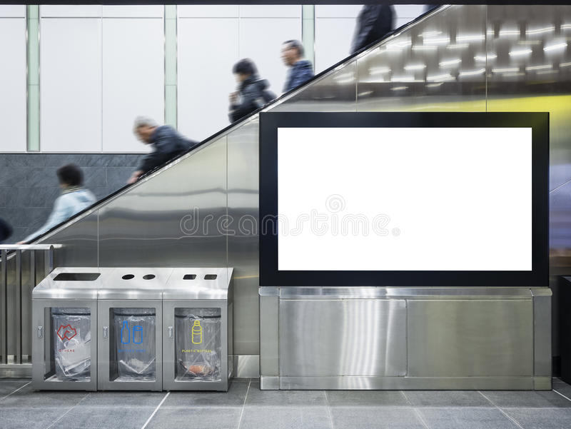 Mock up Lcd screen Public building with people on escalator. And recycle bin stock images