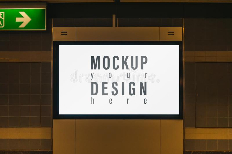 Mock up of light box in a city on the wall for your advertising. Blank mock up of vertical street poster billboard for your text. Message or promotional content stock photo