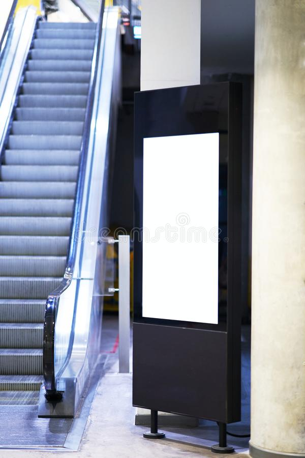 Mock up of light box beside escalator for advertising material stock photo