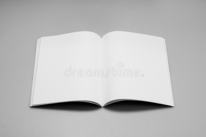 Mock-up magazines, book or catalog on gray table background. royalty free stock image