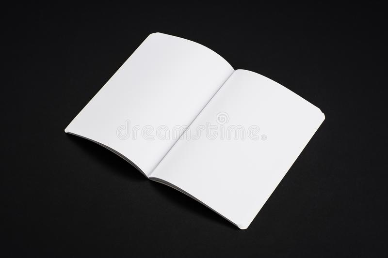 Mock-up magazines, book or catalog on black table background. royalty free stock photography