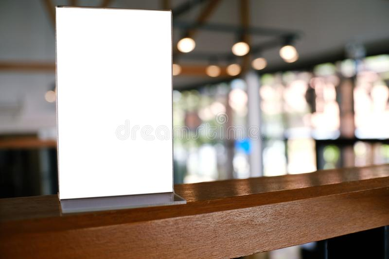 Mock up Menu frame standing on wood table in Bar restaurant cafe stock photo