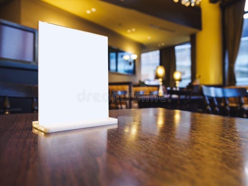 Mock up Menu frame on Table interior Bar Restaurant Cafe table. Seats stock images