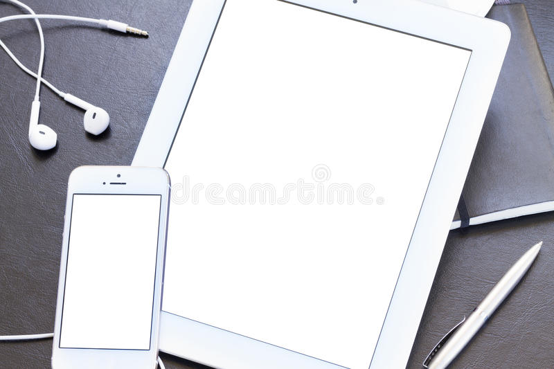 Mock up with modern smartphone and tablet stock photography