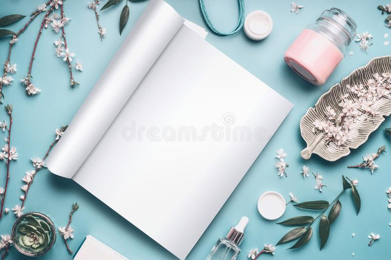 Mock-up of open magazine or catalog for beauty and cosmetic products on pastel blue desktop royalty free stock images