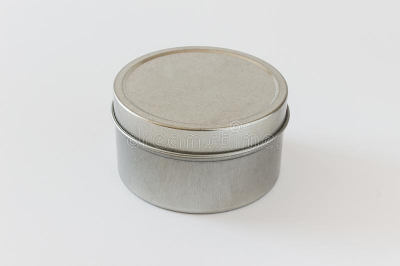 Mock up metal jar tin can for presentation on white background. Mock up packaging round jar, tin can, with a cap made of brushed metal with empty blank surfaces royalty free stock photography