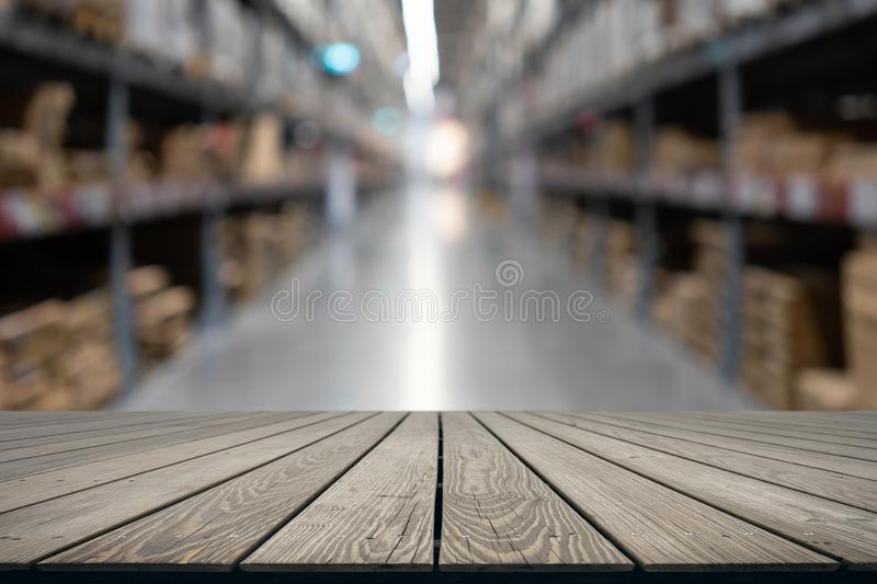 Mock up perspective empty top wooden board with Abstract blurred. using as background montage concept with copy spaces and white royalty free stock photo