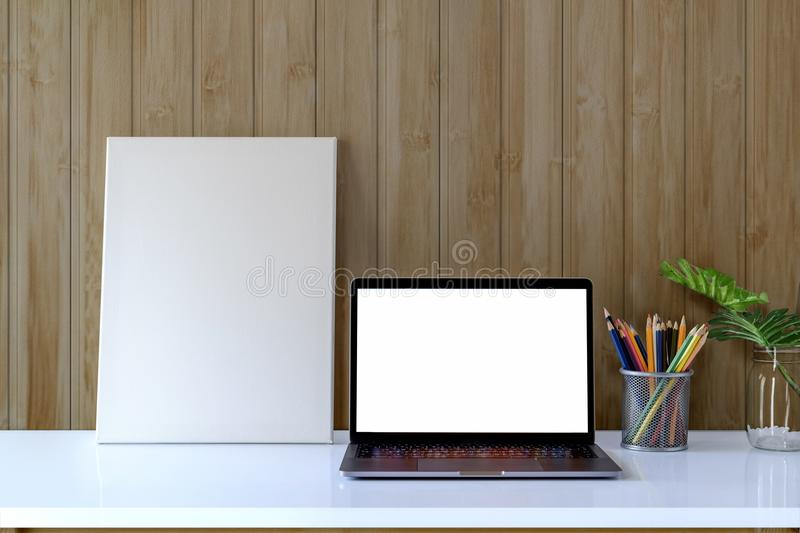 Mock up photo frame with laptop and supplies. stock image