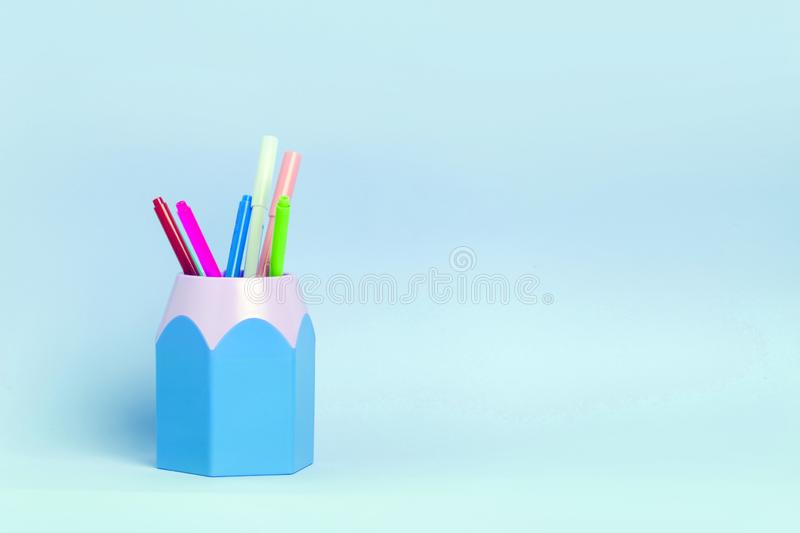 Mock up picture ofoffice supplies, pencil holder on blue background. Copy space for your text stock photography