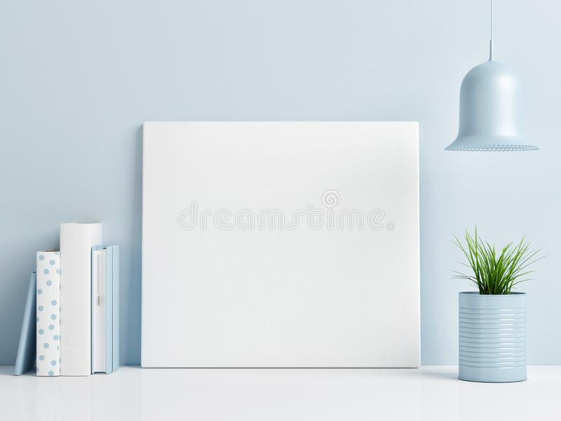 Mock up poster on blue background wall, royalty free stock photo