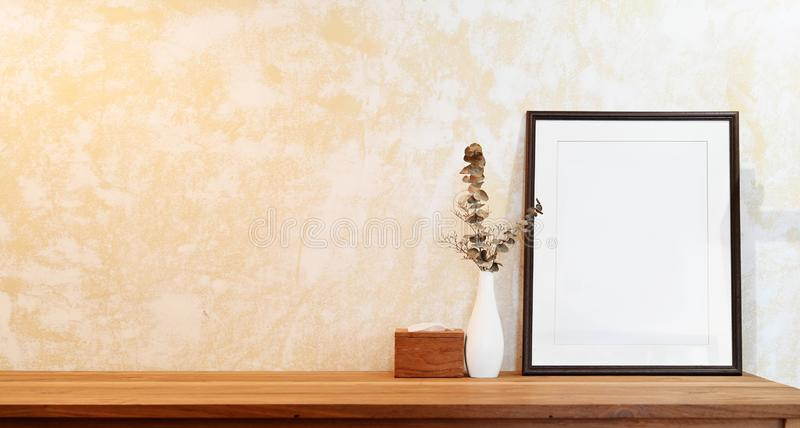 Mock up poster frame on wood table workspace stock photography
