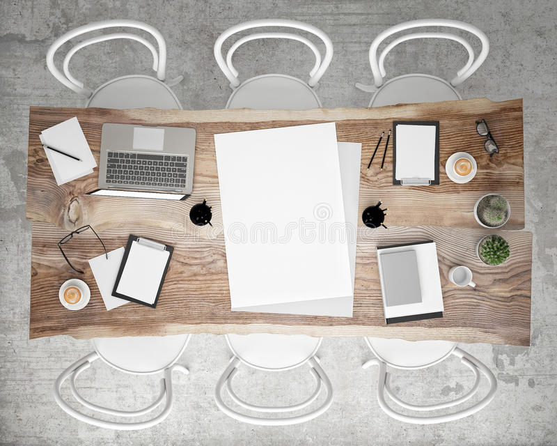 Mock up poster meeting conference table with office accessories and laptop computers, hipster interior background, royalty free stock image
