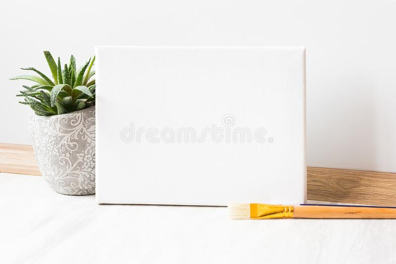 Mock-up poster frame. Mock-up poster and paint brush stock photos