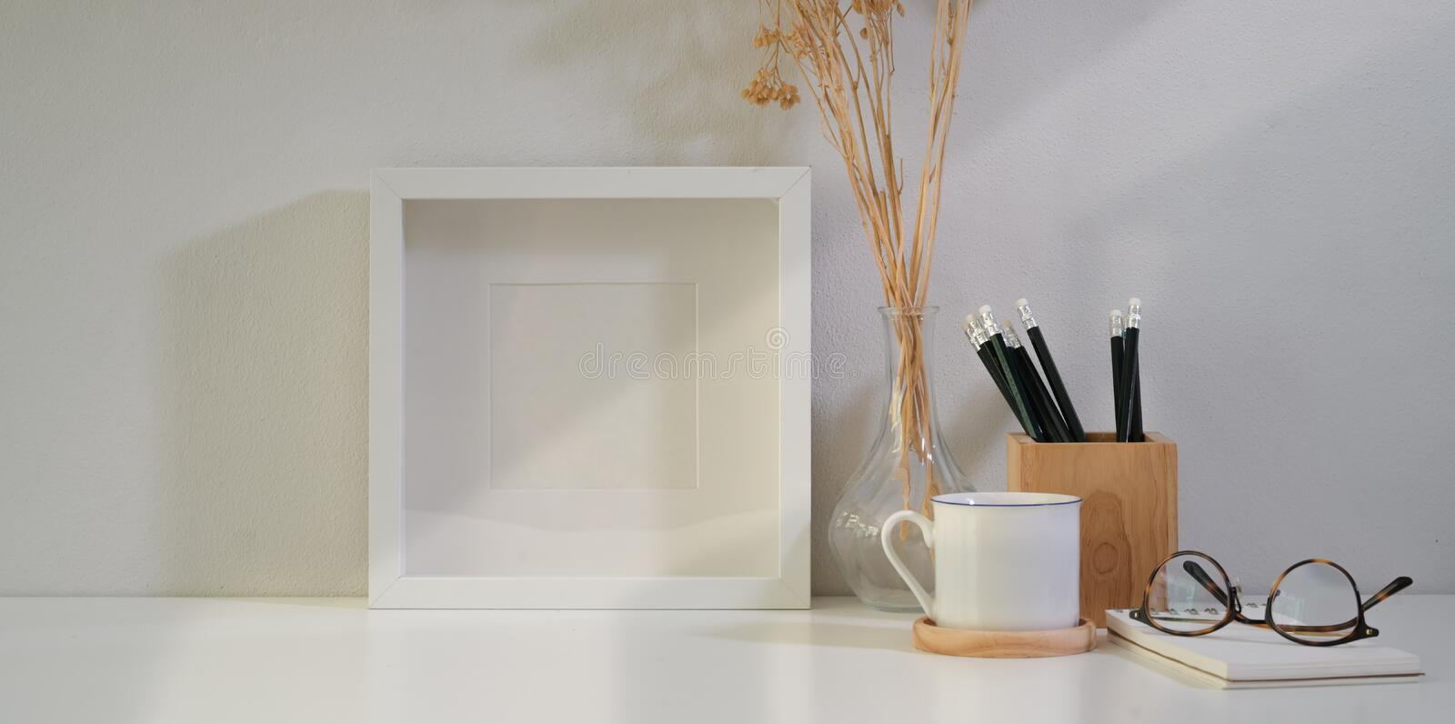 Mock up poster or photo frame and supplies royalty free stock photography