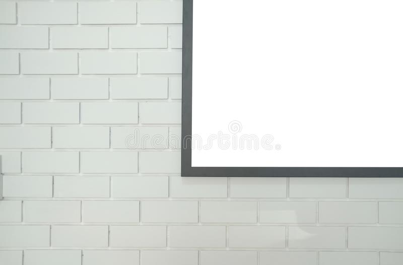 mock up poster photo frame on white brick wall royalty free stock photography