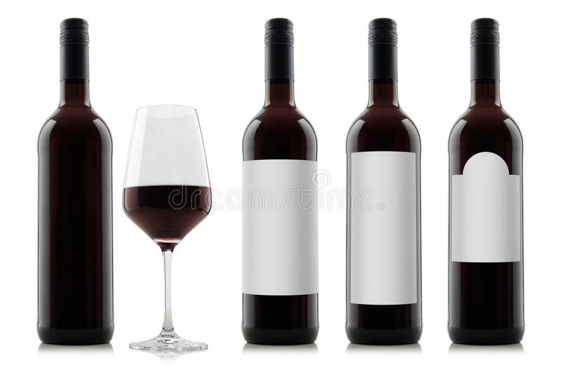 Mock-up of red wine bottles with blank white labels and a glass of wine royalty free stock photos