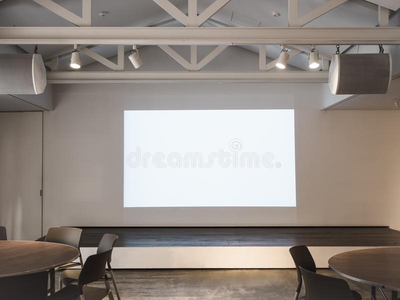 Mock up Screen in Meeting room with table and seats Business Presentation stock photo