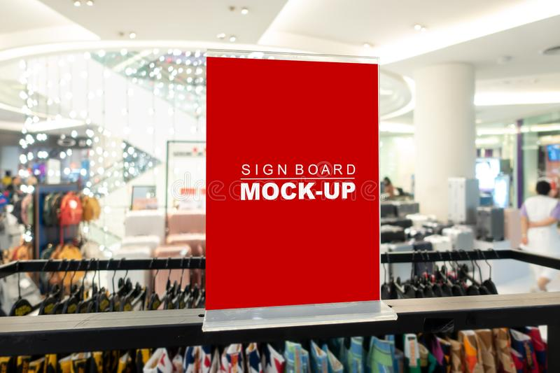 Mock up sign board in fashion clothes shop. Mock up horizontal blank signboard in acrylic frame with clipping path to show promotion or price at fashion clothes royalty free stock images
