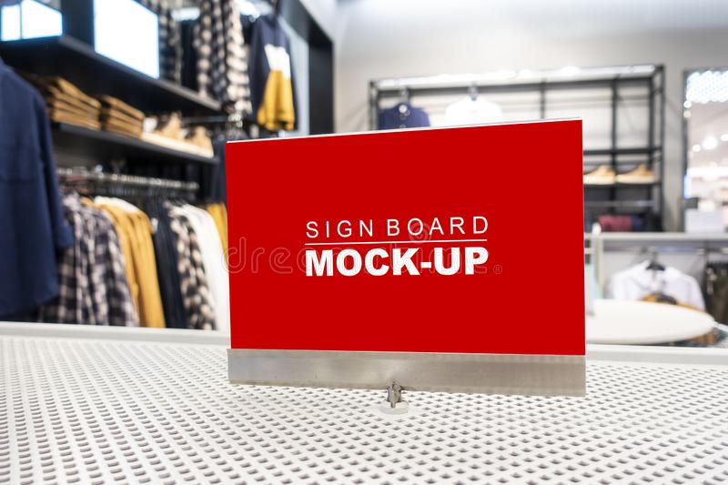 Mock up signboard on showcased in clothing shop. Mock up perspective blank billboard with clipping path to show promotion or discount in accessory and clothing stock photography