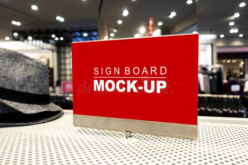 Mock up signboard on showcased in clothing shop. Mock up perspective blank billboard with clipping path to show promotion or discount in accessory and clothing stock photo