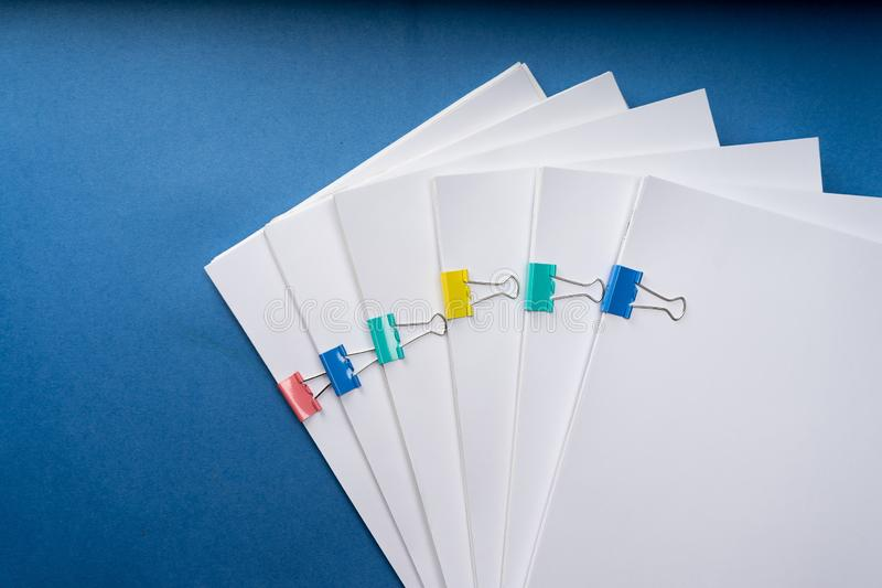 Mock up, stack of papers documents in archives files with paper clips on desk at offices, business concept. Copy space stock photo