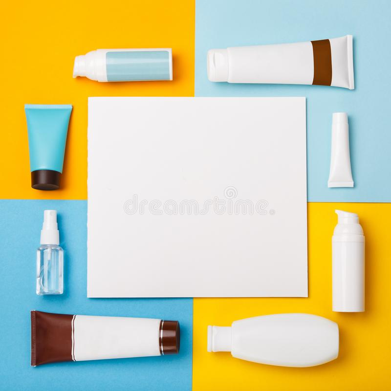 Mock up summer skin care cosmetics on yellow and blue background. White bottles of woman cosmetics on yellow. Summer holidays or vacation. Preparation for stock photo