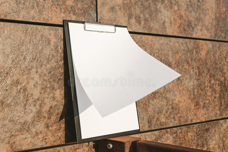 Mock Up of the tablet for the paper against the wall royalty free stock images