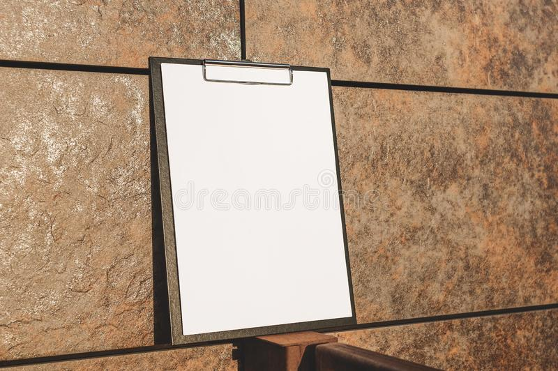 Mock Up of the tablet for the paper against the wall. stock image