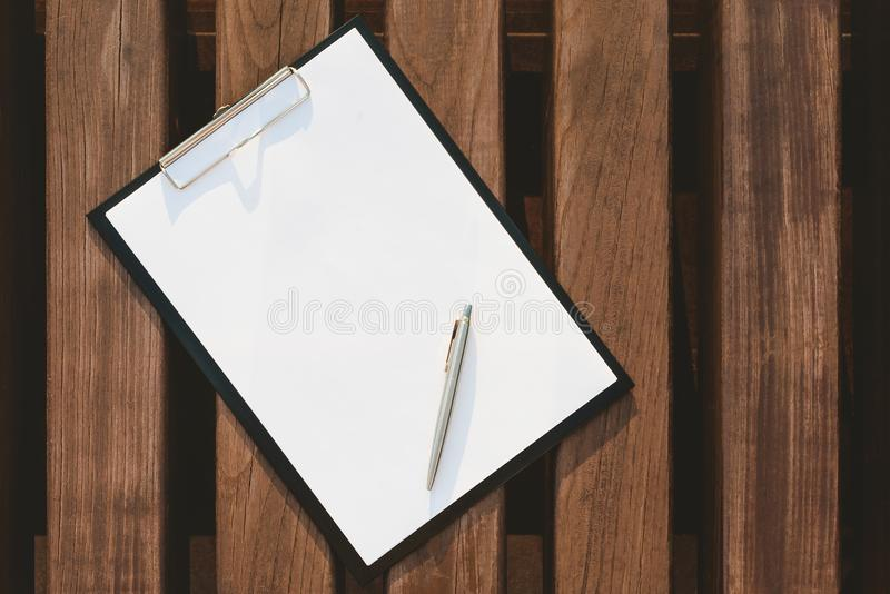 Mock Up of the tablet for the paper on the background of wooden wall. royalty free stock image