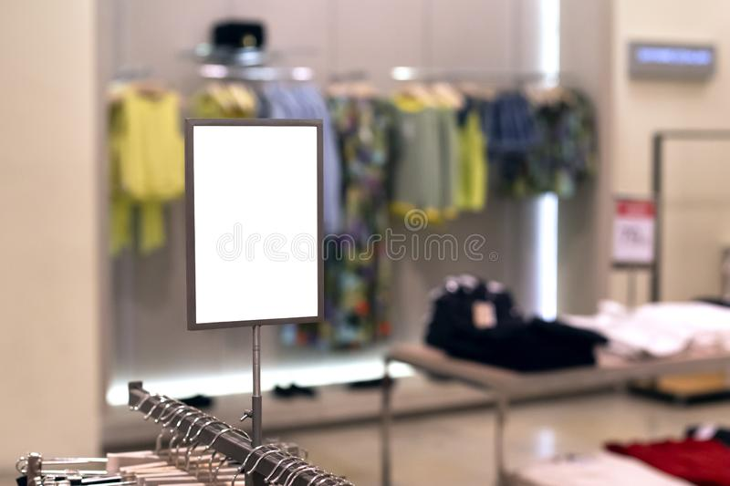 Mock up template of sales information banner or tag price in clothing store. Frame with copy space. Mock up template of sales information banner or tag price in royalty free stock photo